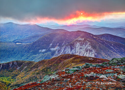 Photograph of sunset and Greenleaf AMC Hut from Mount Lafayette