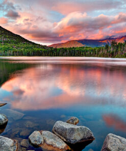 Photograph of Lonesome Lake with pink clouds